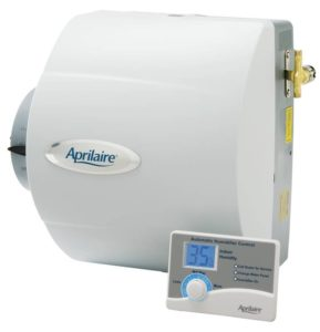 We can see the furnace-mounted Aprilaire 400 from a front-side perspective, as well as the digital humidistat control panel