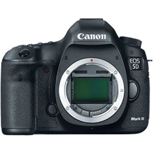 The robust Canon EOS 5D Mark III is turned towards the camera with the shutter open