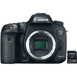 The Canon EOS 7d Mark II faces the camera with an SD card posed next to it