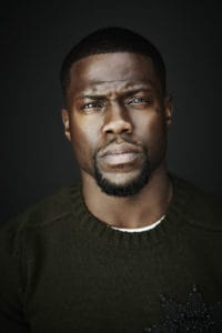 Kevin Hart stares at the camera with a serious expression on his face