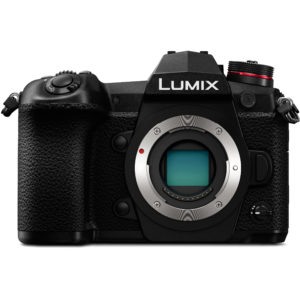 The Panasonic G9 Lumix is posed facing the viewer with only its body camera