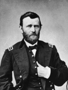 The 18th president has his hand in his shirt while wearing his general uniform