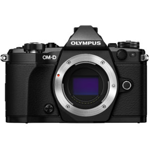 The retro-looking Olympus OM-D E-M5 Mark II camera faces us with its shutter open