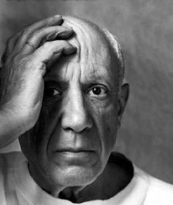 An elderly Pablo Picasso holds up his head with his right hand resting on his forehead