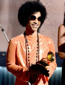 Prince smiles as he accepts a Grammy Award at the 57th Grammy Awards event