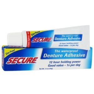 A tube on top of a Derek Secure Dental Cream