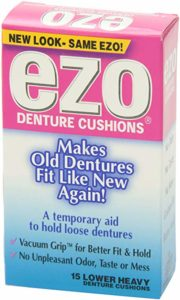 A box of Ezo Cushions Denture Adhesive Strips is turned to the camera