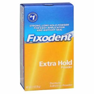 A yellow and blue case of Fixodent Extra Hold Denture Adhering Powder