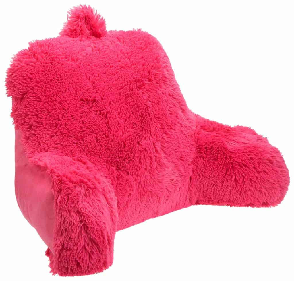 The pink plush Shagalicious bed rest pillow has a handle at the top