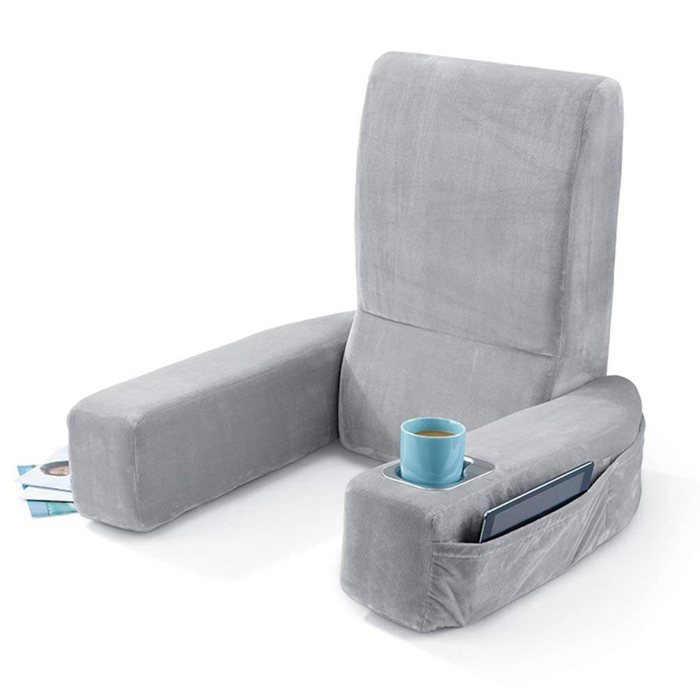 Photo taken of the Brookstone husband pillow with arms, a cupholder, and side pockets