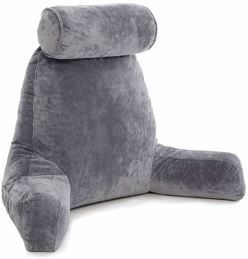 A gray husband pillow is tilted toward the camera with its armrests and headrest in place