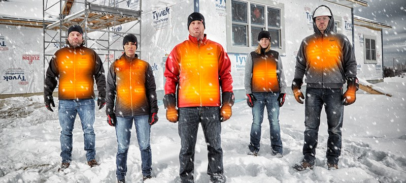 Five men stand in the snow in their heated jackets that show the warmth areas at the front of the coat