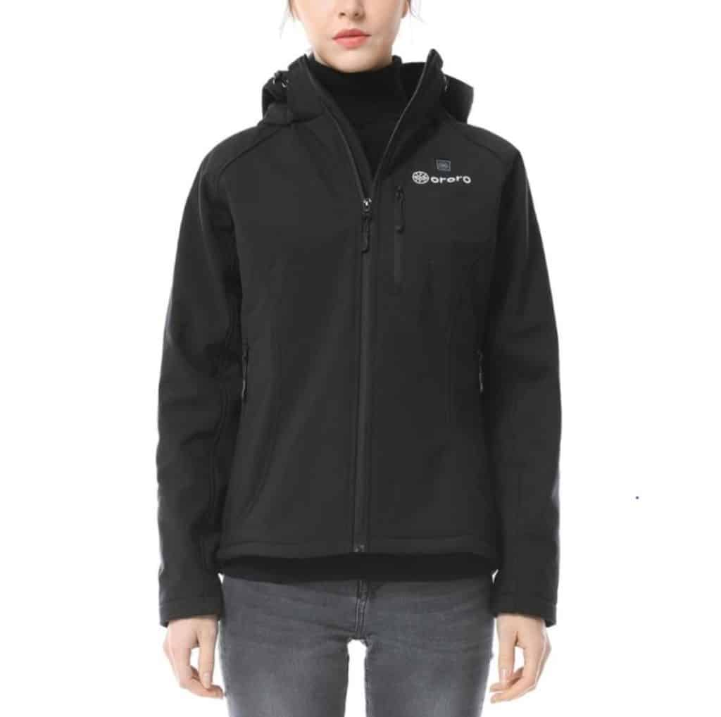 A woman poses for the camera while wearing the Ororo Women's Heated Jacket in black